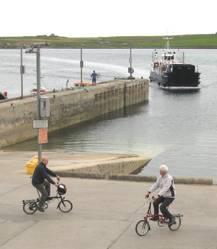 Cyclists at Rousay ferry, Orkney.
