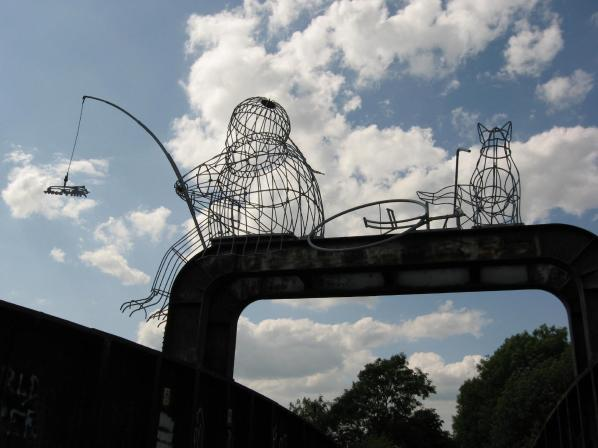 The fisher of dreams sculpture on Naburn rail bridge