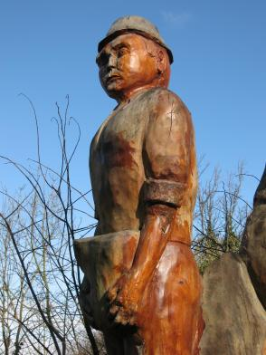 Wooden figure on canal, Route 75